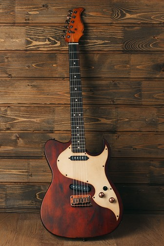 electric guitar against a wood background